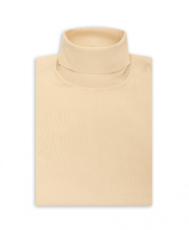 Cream-colored turtleneck sweater in...